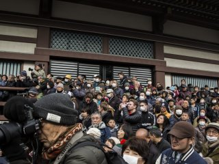 Japanese and foreigners alike head to Nishiarai Daishi Temple's Komyoden, a ceremonial venue, to watch Daruma Kuyo.