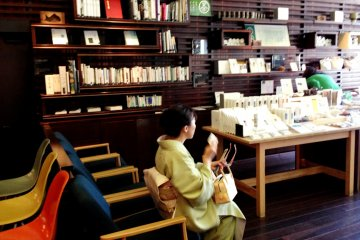 The gift shop at Iyemon Salon Cafe Karasuma Sanjo Kyoto has a visually appealing display of tea books and related accessories