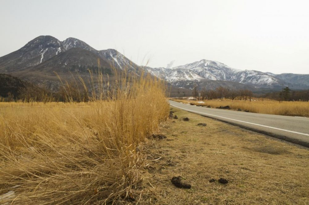 The Chojabaru Plateau along the Yamanami Highway (Rt. 11) with a steaming Mt. Hossho in the background
