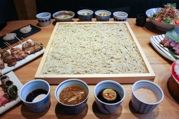 Kakomi-soba with surrounding dipping sauces (from ¥980 for 2 people) – choose from a variety of 11