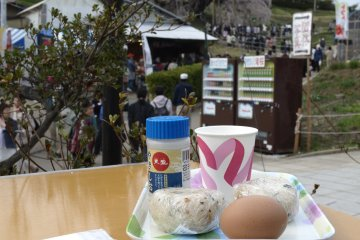 A cup of amazake, rice balls, and a piece of boiled egg for lunch