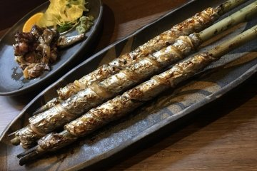 Tachimaki is scabbardfish wound around bamboo and barbecued. Enjoy it; you won't find this anywhere else on the planet.