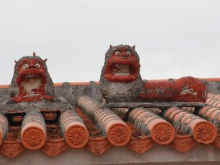 Its unusual to see two shisa dogs on a roof and rare to see them placed next to each other