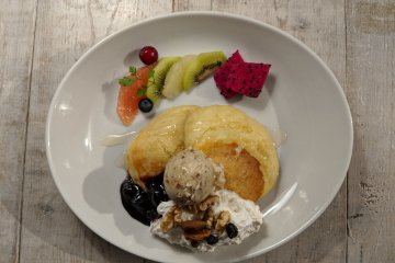 Another pancake variety served with fresh fruits and vegan ice cream