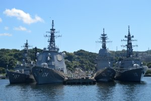 Double docked navy vessels