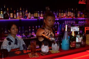 Bartender serving drinks