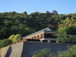 The view up to Matsuyama Castle from the moated park
