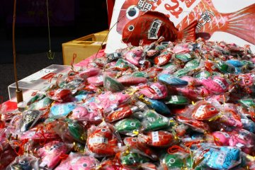 A number of booths within the shrine grounds sell charms and other religious items to worshippers. You can try your luck 'fishing' with a small rod for one of these papier mache fish, each containing a paper slip with a fortune written on it.