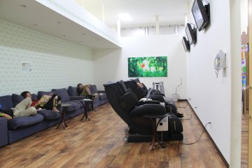 <p>The relaxation room features sofas, television, an internet terminal and massage chairs</p>