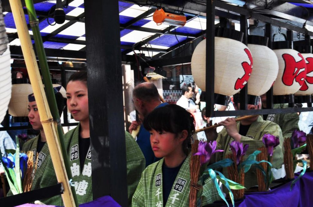 People playing traditional drums and flutes in the procession