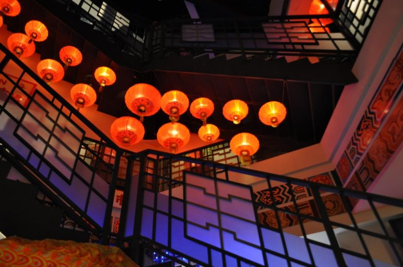 Beautiful red lanterns spiral up the staircase
