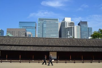 The long defense house beyond tall buildings along another way to the Honmaru Area.