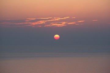 The sun on the misty horizon