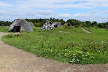 The structures with thatched roofs are particularly intriguing