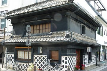 old merchant style house with traditional criss-cross pattern on the wall