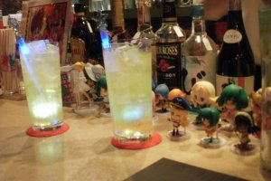 Drinks glow as figures look on