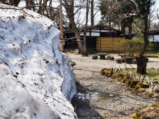 A huge mound of snow that was slowly melting in the heat.