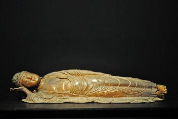 Buddha in Nirvana. 13th century Japanese Buddhist sculpture.