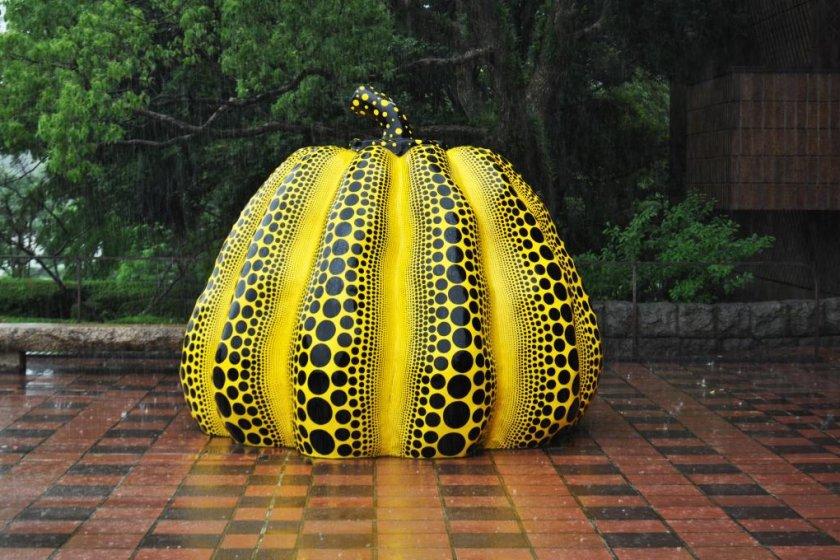 The Yayoi Kusama sculpture outside titled \'Pumpkin\'.