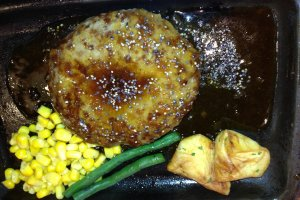 Seasoned hamburger plate with savory sauce and vegetables