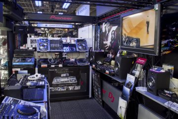 Practice mixing tunes with turntables and shiny knobs in the hands-on DJ booths