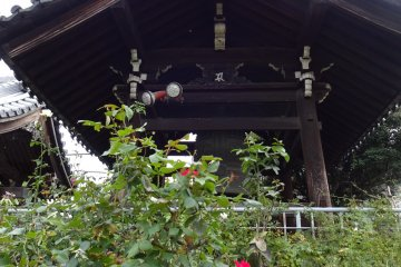 Temple bell near the entrance, and roses