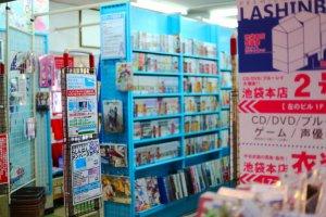 The shops have a vibrant style similar to Akihabara