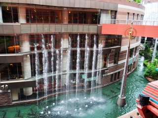 A view of the canal below with the water fountain show.