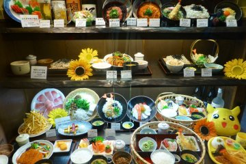 Restaurants will tempt you inside with their colorful food displays in their shop windows