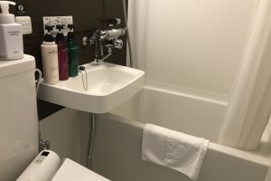 The bathroom is equipped with amenities like shampoo, conditioner and body wash, allowing you to pack light