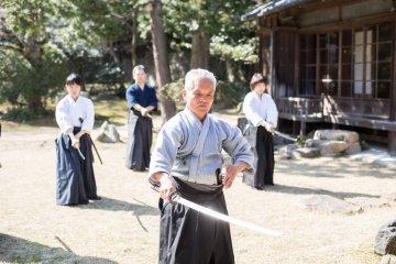 A master teaching Japanese sword