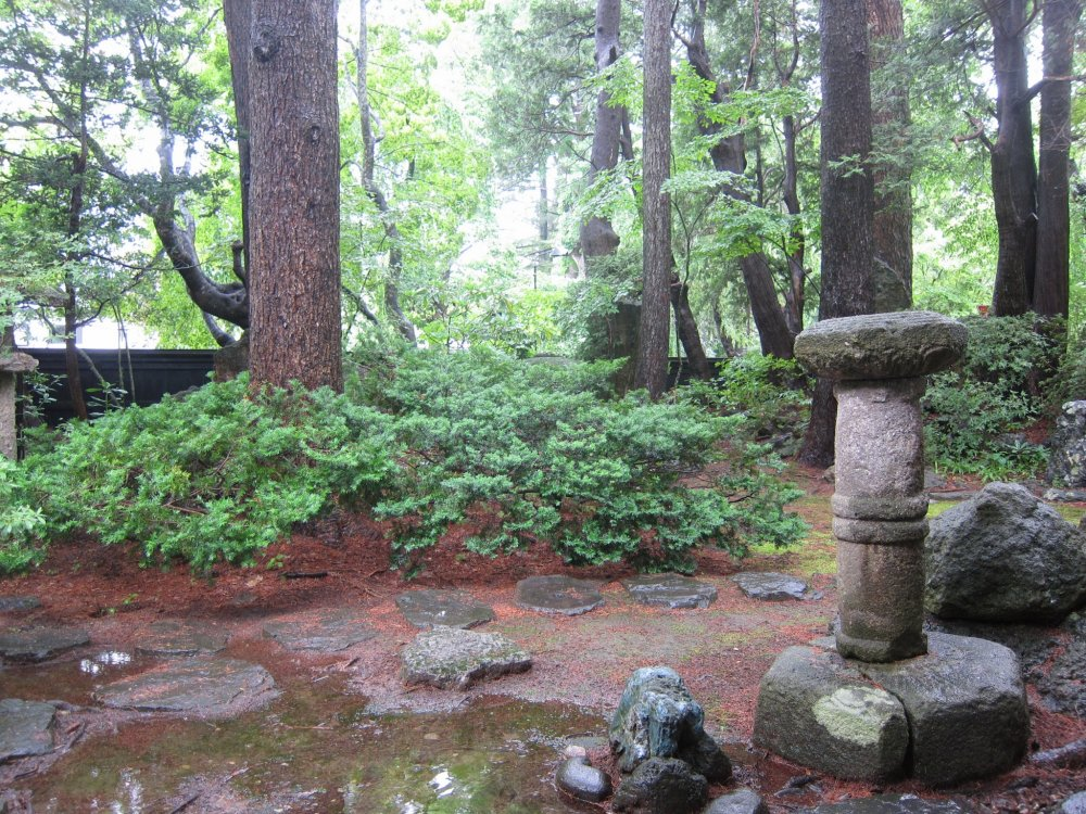 it was pouring rain, but still this traditional japanese garden is a sight to behold