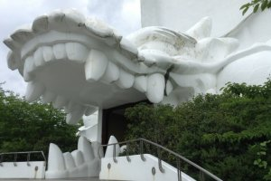 The entrance at the base of the statue is a dragon's mouth! It looks like you are on the menu!