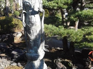 A serene statue close to the worship hall