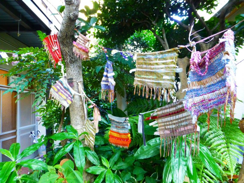 Colorful pieces of cloth hang outside the World Friendship Center