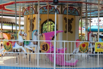 The colorful Mini Amusement area features a number of rides for small children.
