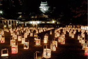 Hundreds of hand-made paper lanterns are laid in and around the castle grounds for Matsue Suitoro