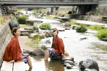 Enjoy free hot spring foot baths by the river