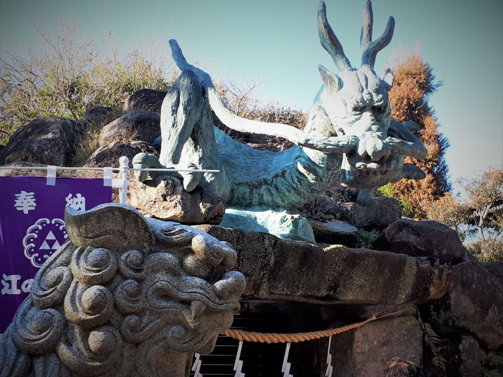 Some very serious characters watching over the Wadatsumi no Miya Dragon Shrine
