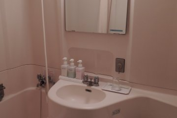 Bathroom with basic amenities such as soap and toothbrush all provided