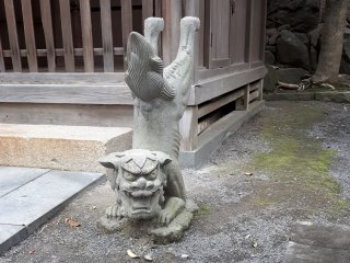 Komainu lion-dog standing.... watch over the shrine and warding away evil spirits.