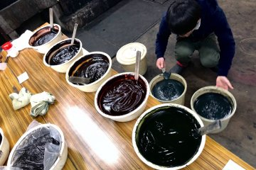 A staff hard at work preparing the dyes