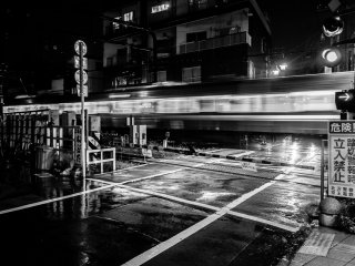 """Rainy August in Tokyo -- there's nothing as poetic as a B&W photo of Tokyo train crossroads after the rain... So I thought, and this picture still provokes a lot of feelings in me, but I grew to change the lenses I viewed Japan with shortly after this """"honeymoon"""" period."""