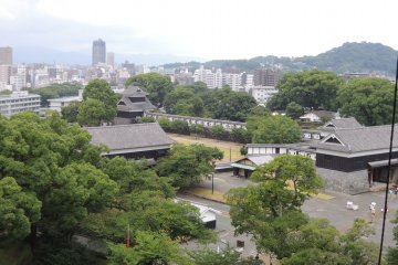 Contrast between the traditional Japanese buildings and the modern city