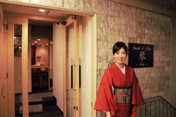 Ms. Miyuki Takeshita in front of the store entrance