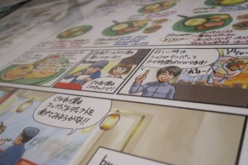 The placemats feature a clever manga about the shop owners at Breaq!