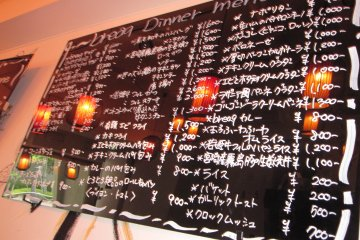"""The menu boards on the walls are in a """"chalkboard"""" design."""