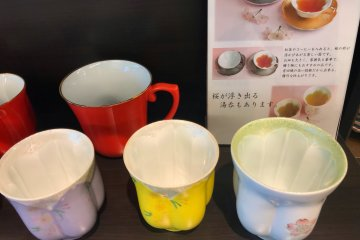 These tea cups are designed so that when you fill them the tea takes on a sakura shape