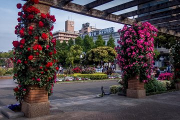 Many of this park's colorful displays are situated in front of the famous 'New Grand Hotel'