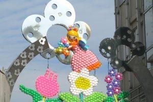 Spring sign at the entrance to Takeshita Street in Harajuku